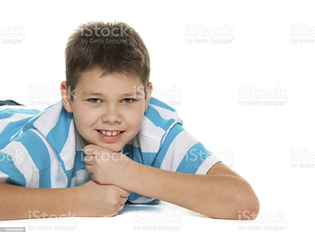 Cheerful handsome boy on the floor royalty-free stock photo