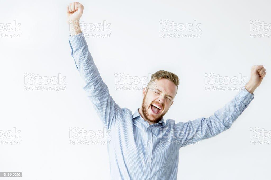 Cheerful Handsome Man Celebrating Success stock photo