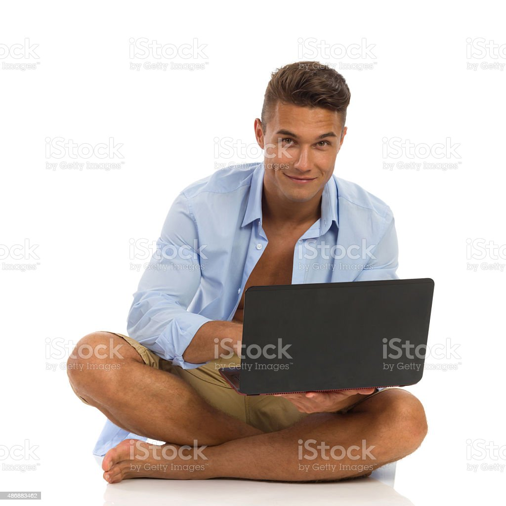 Cheerful Handsome Man With Laptop stock photo