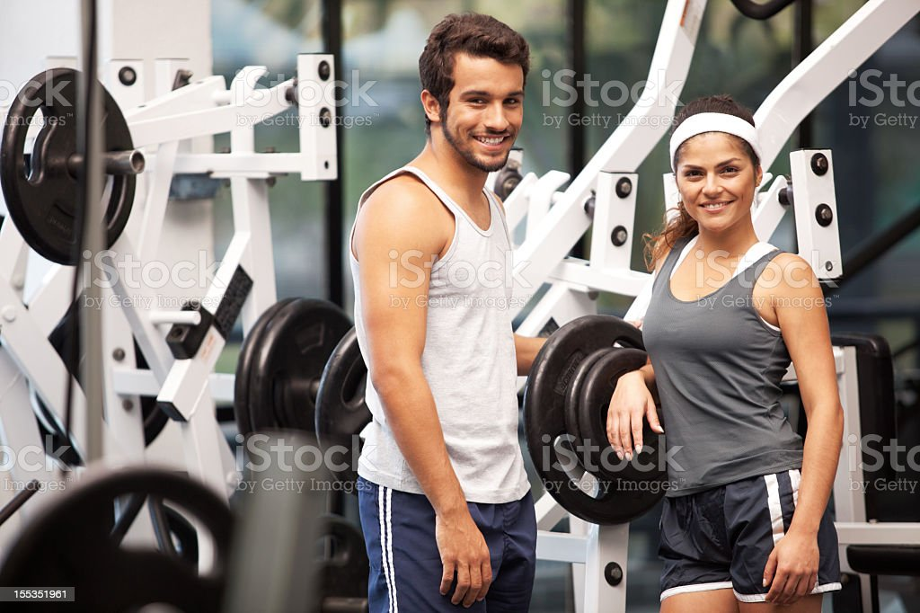 Cheerful happy and young people at the fitness club. royalty-free stock photo