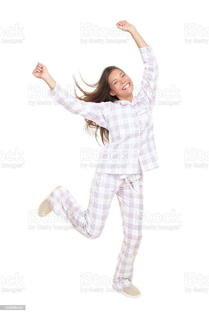 Cheerful happy dancing pajamas woman stock photo