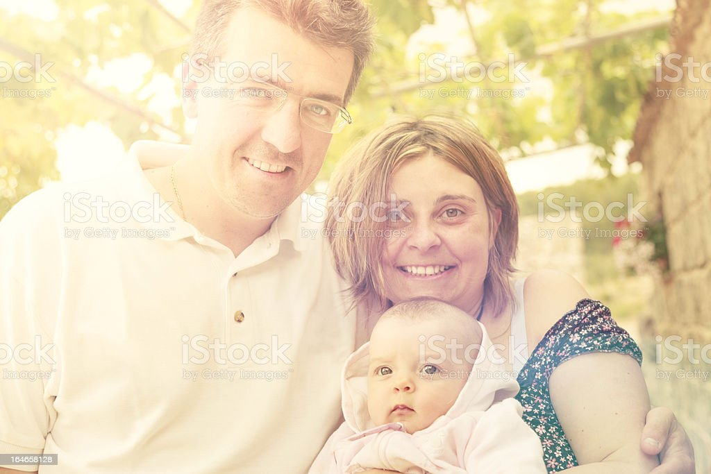 Cheerful Happy Family Portrait Outdoor. Backlight stock photo