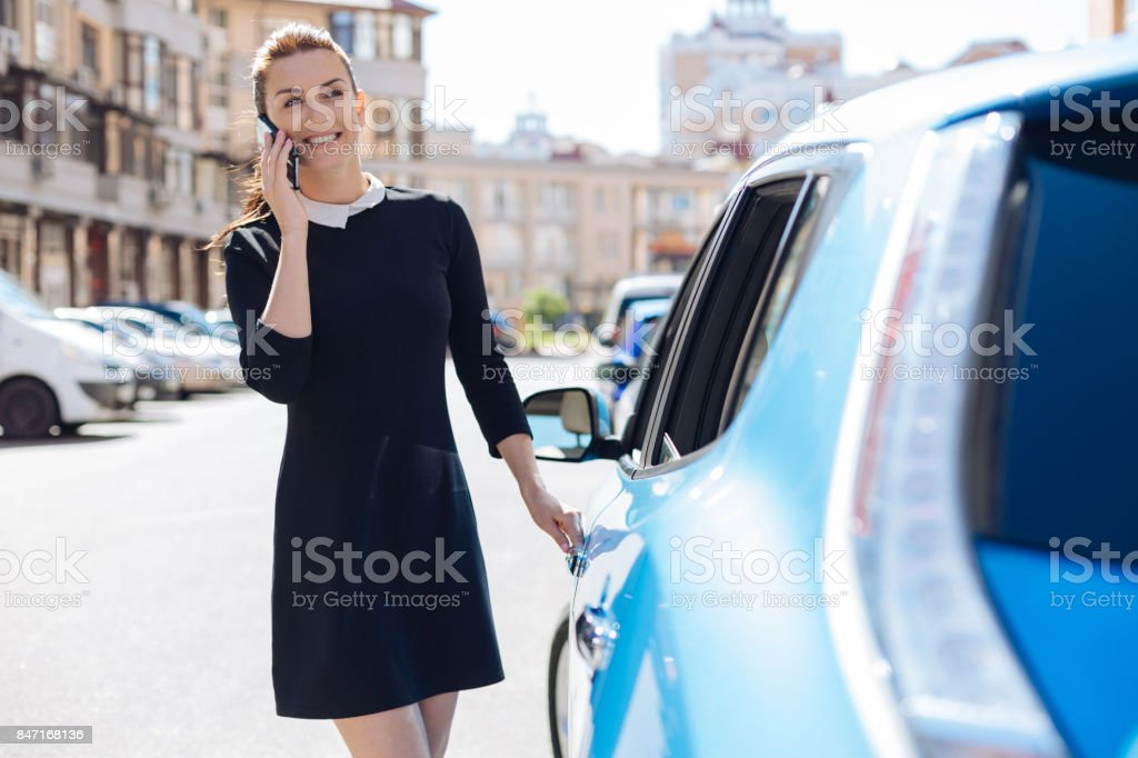 Cheerful happy woman having a phone conversation stock photo