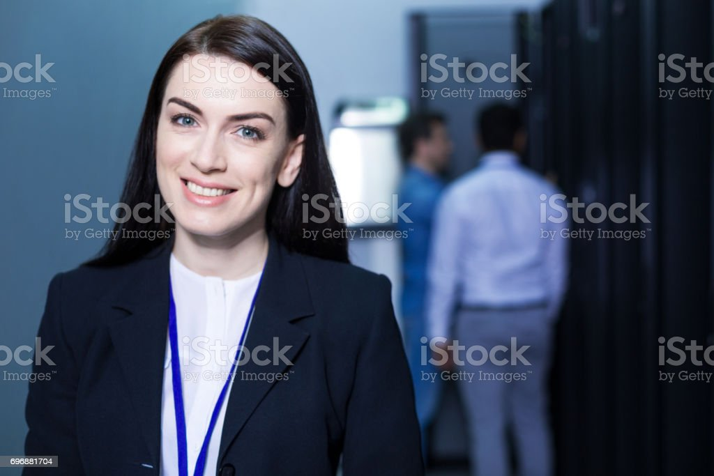 Cheerful happy woman looking at you stock photo