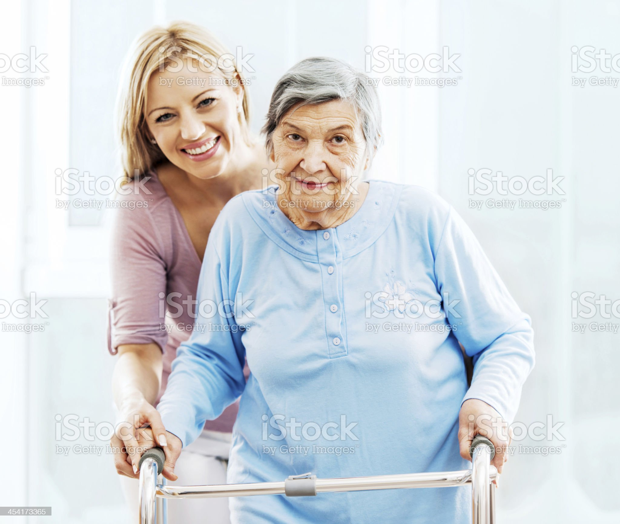 Cheerful healthcare worker with a patient. royalty-free stock photo