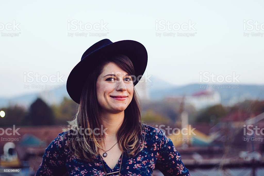 Cheerful hipster girl dress in urban viewport stock photo