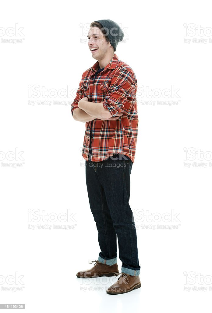 Cheerful hipster standing and looking away stock photo