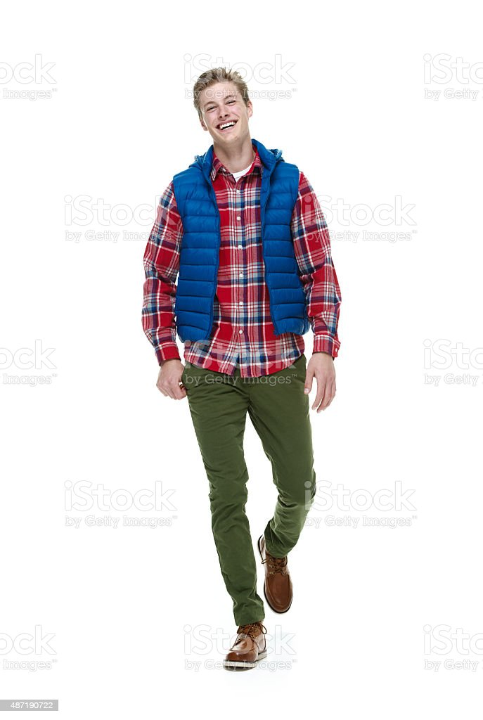 Cheerful hipster walking stock photo
