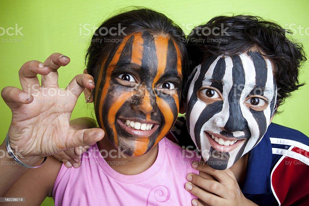Cheerful Indian Boy and Girl wearing Zebra Tiger Strips Horizontal royalty-free stock photo