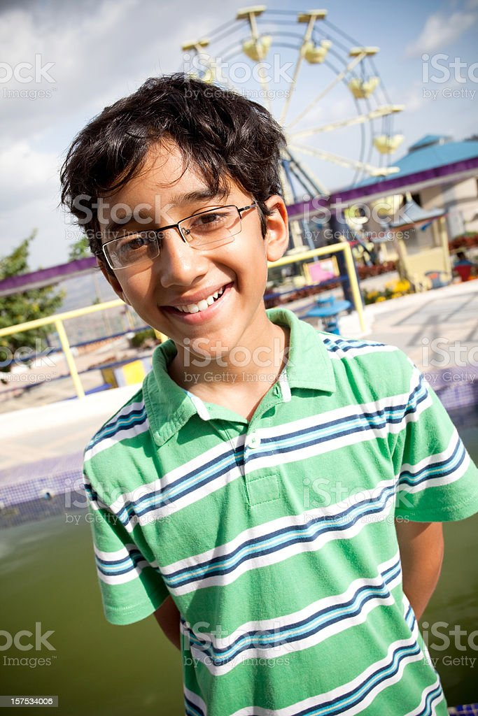 Cheerful Indian Boy in Amusement Park Natural Light royalty-free stock photo