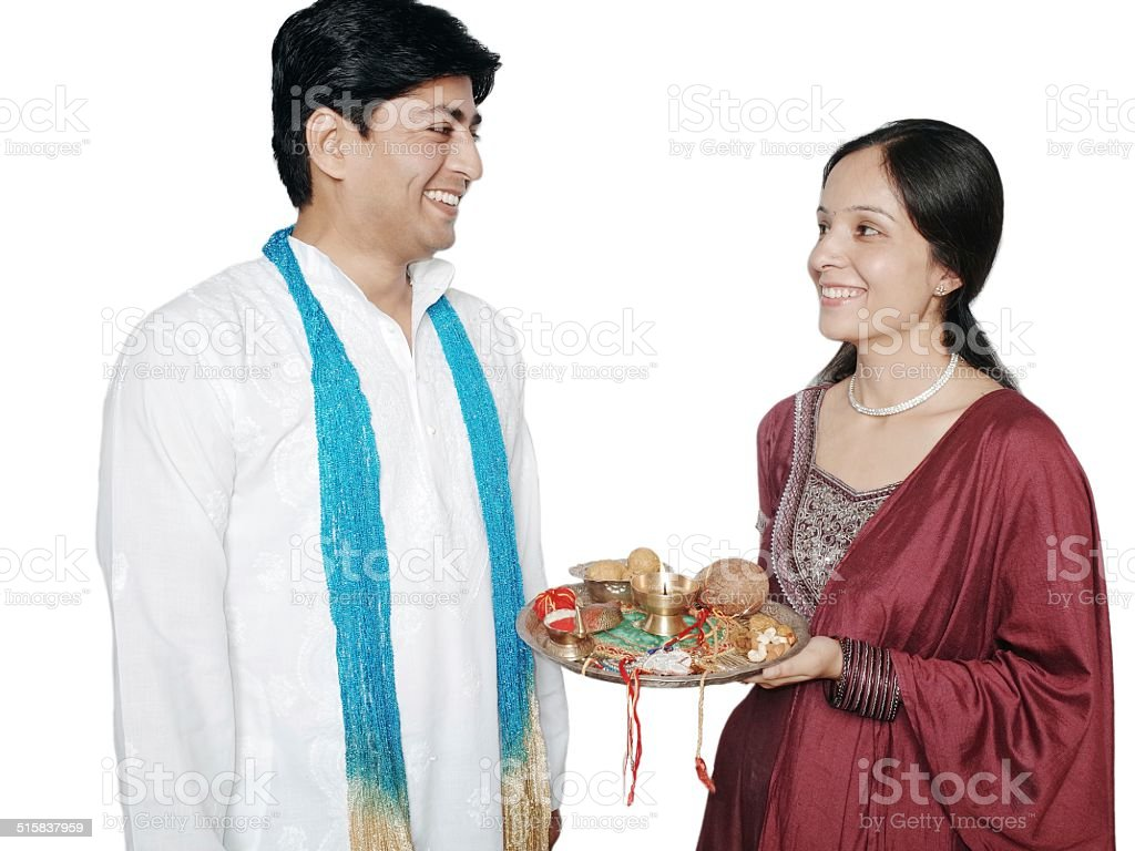 Cheerful Indian brother and sister standing together. stock photo