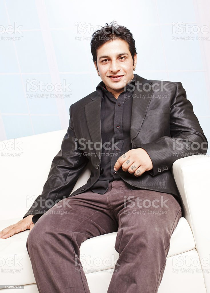 Cheerful Indian Businessman sitting on a Couch royalty-free stock photo
