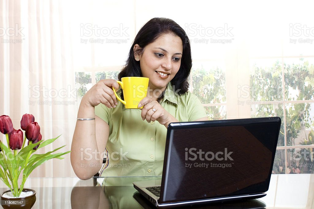 Cheerful Indian Businesswoman using Laptop royalty-free stock photo