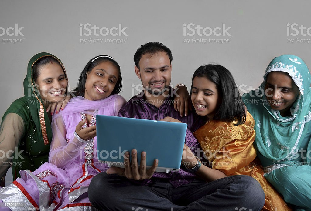 Cheerful Indian Family Holding Laptop Indoor royalty-free stock photo