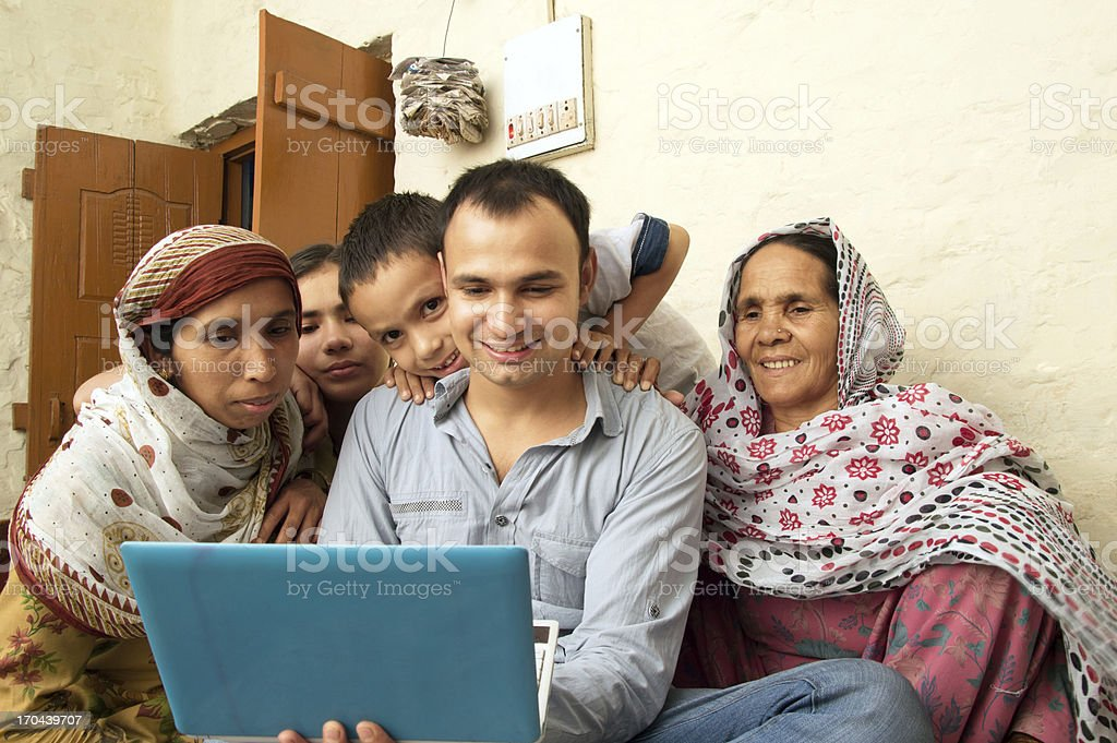 Cheerful Indian Family Holding Laptop royalty-free stock photo