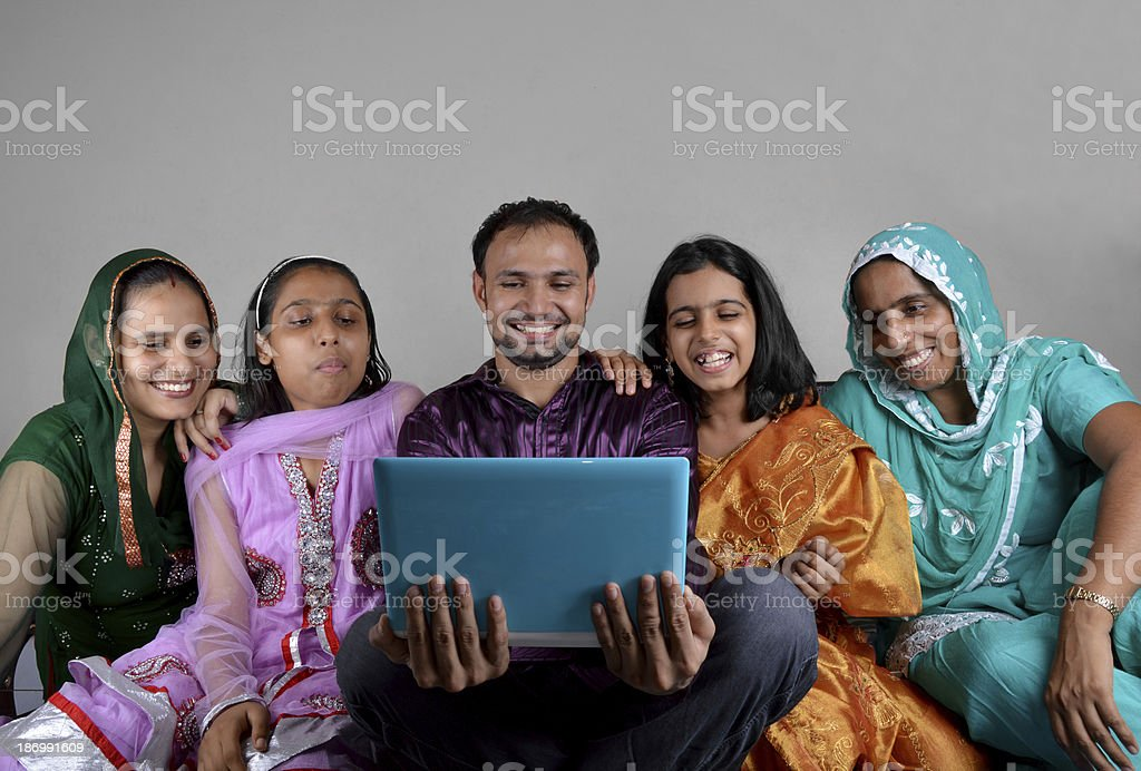 Cheerful Indian Family Using Laptop royalty-free stock photo