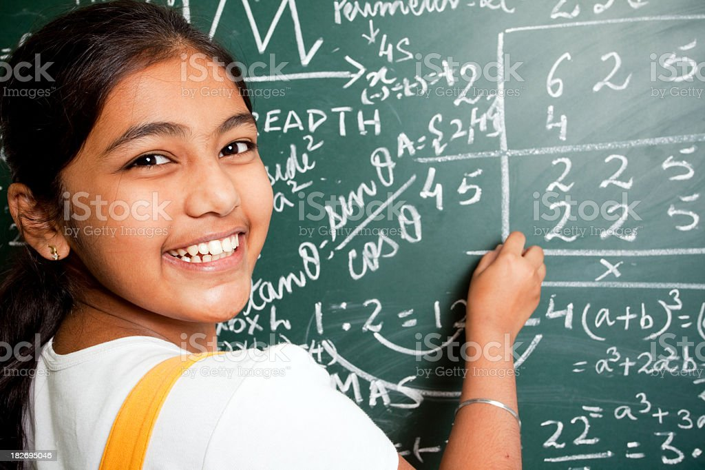 Cheerful Indian Girl Student with Mathematics Problems stock photo