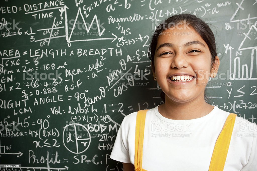 Cheerful Indian Girl Student with Mathematics Problems royalty-free stock photo