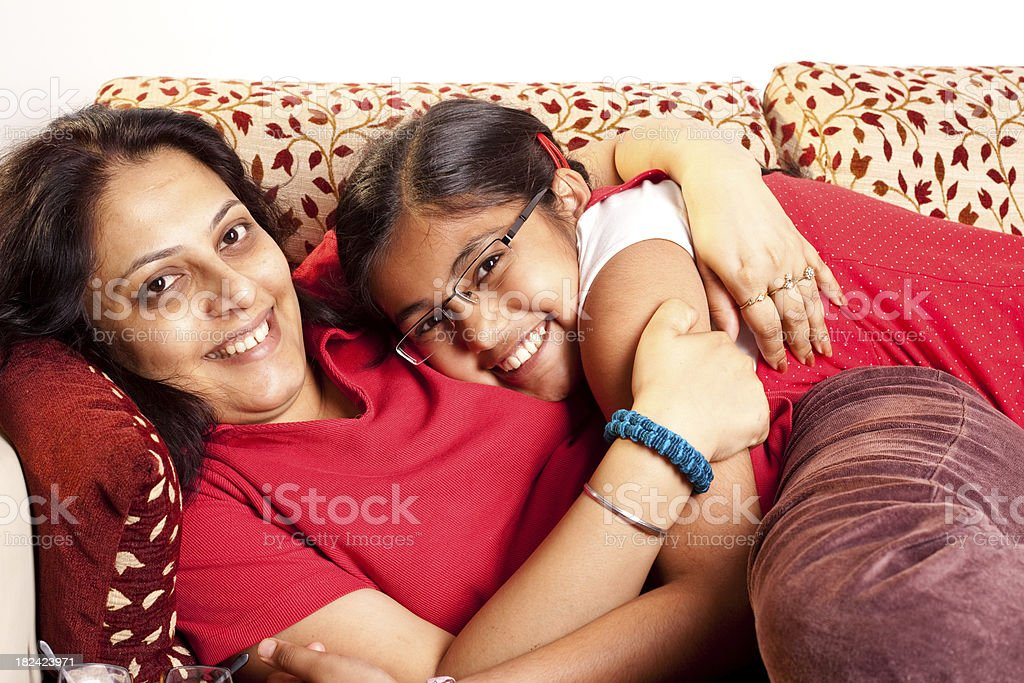 Cheerful Indian Mother and Daughter having fun at home stock photo