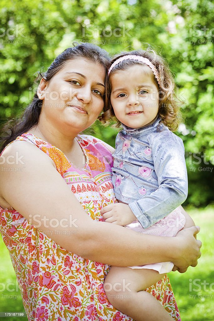 Cheerful Indian mother with her little daughter showing Love affection royalty-free stock photo