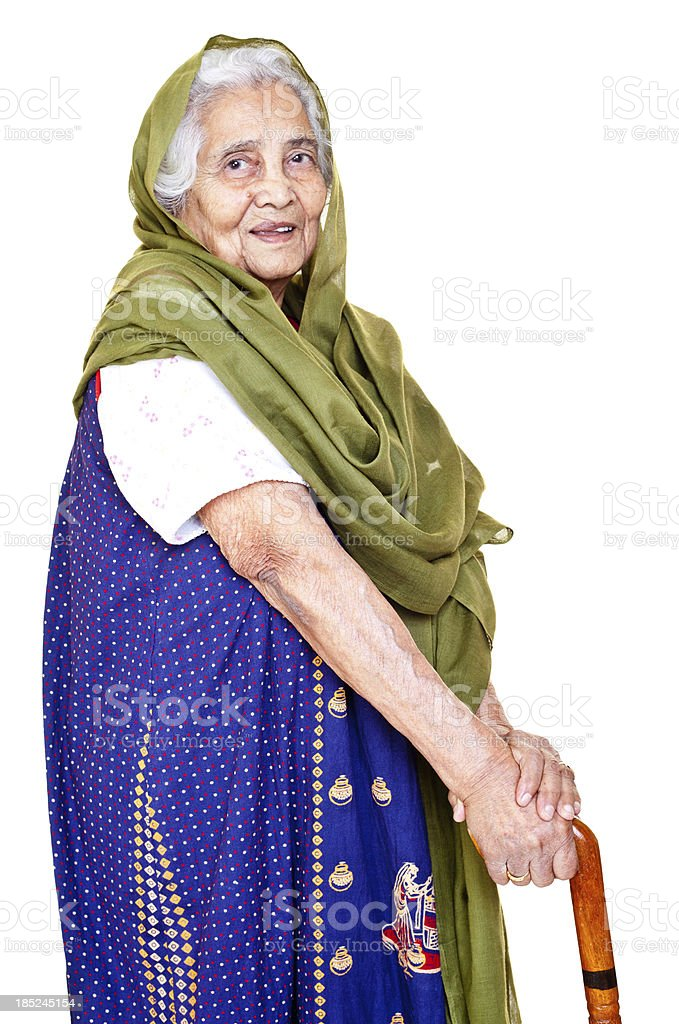 Cheerful Indian Senior Aged Woman with Walking Stick royalty-free stock photo