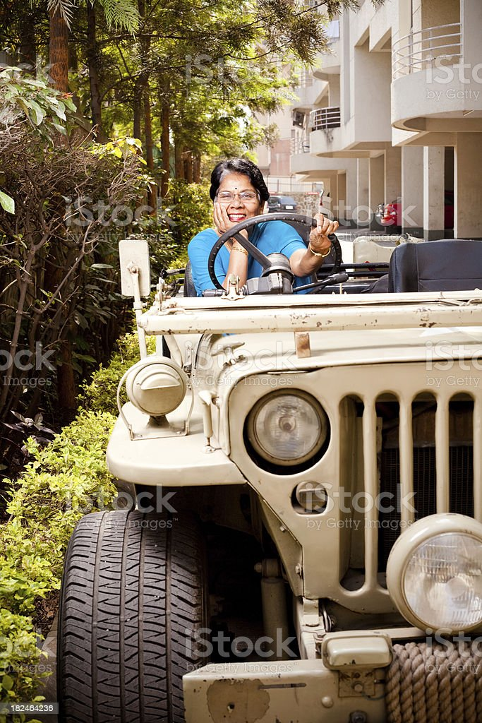 Cheerful Indian Senior Woman with Jeep stock photo