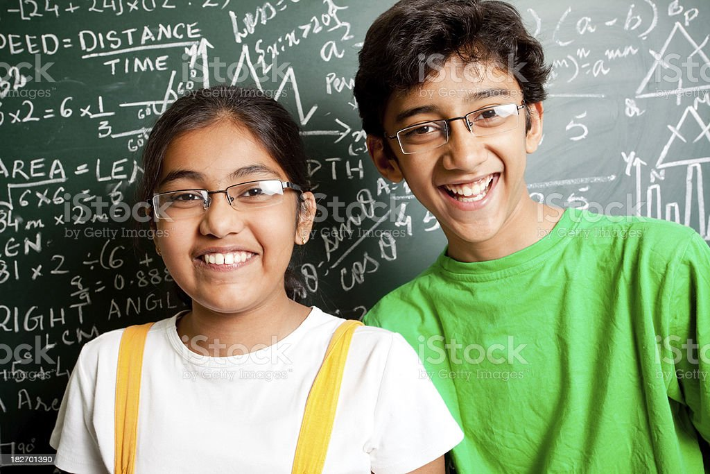 Cheerful Indian Teenager Boy and Girl Student with Mathematics Problems royalty-free stock photo