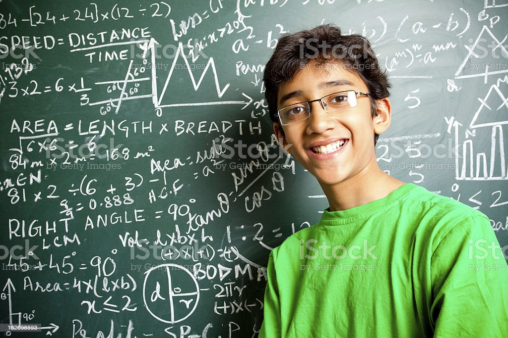 Cheerful Indian Teenager Boy Student with Mathematics Problems Horizontal royalty-free stock photo
