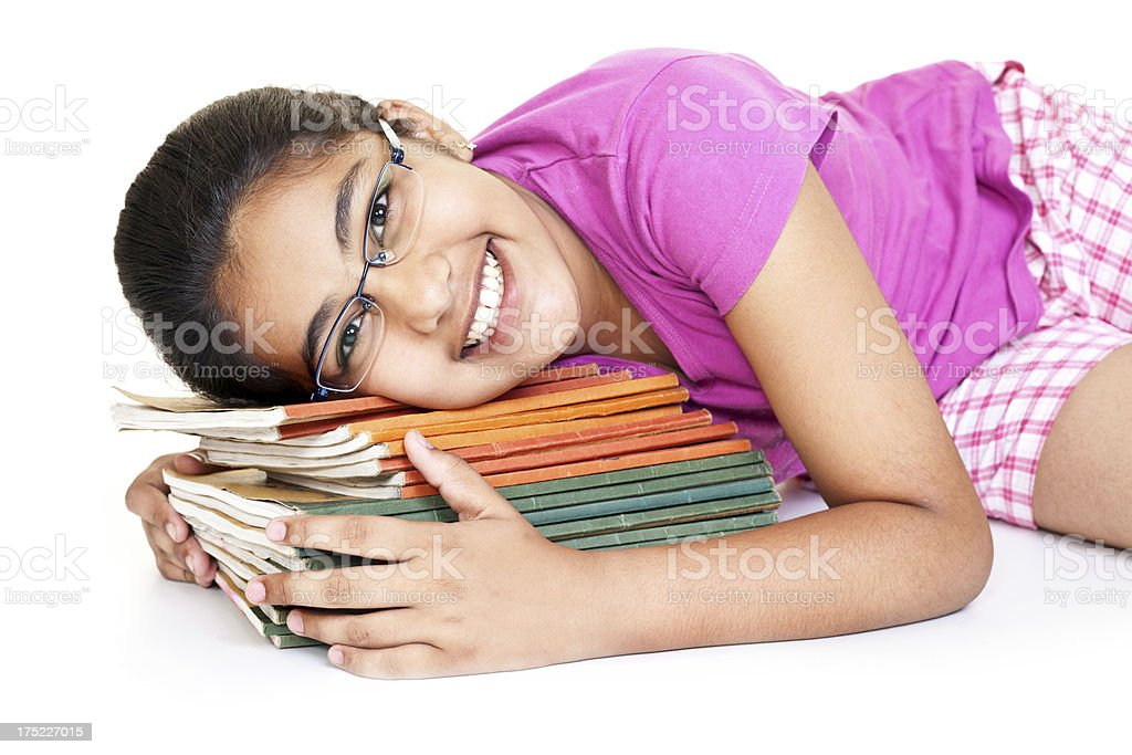 Cheerful Indian Teenager Girl showing love with her School Books royalty-free stock photo