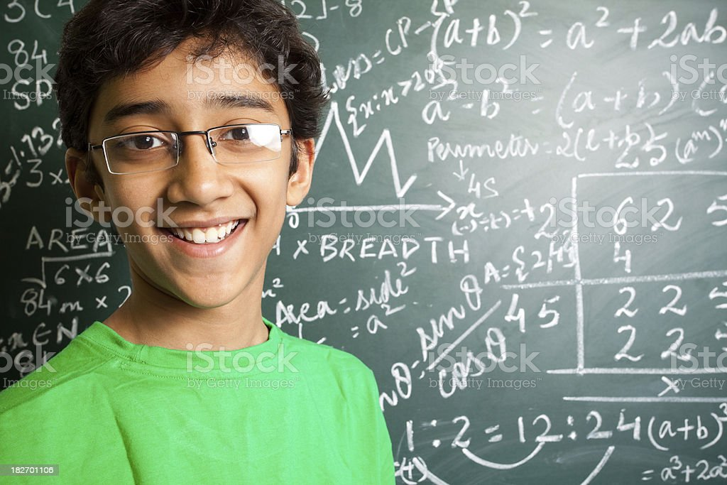 Cheerful Indian Teenager Student with Mathematics Problems royalty-free stock photo
