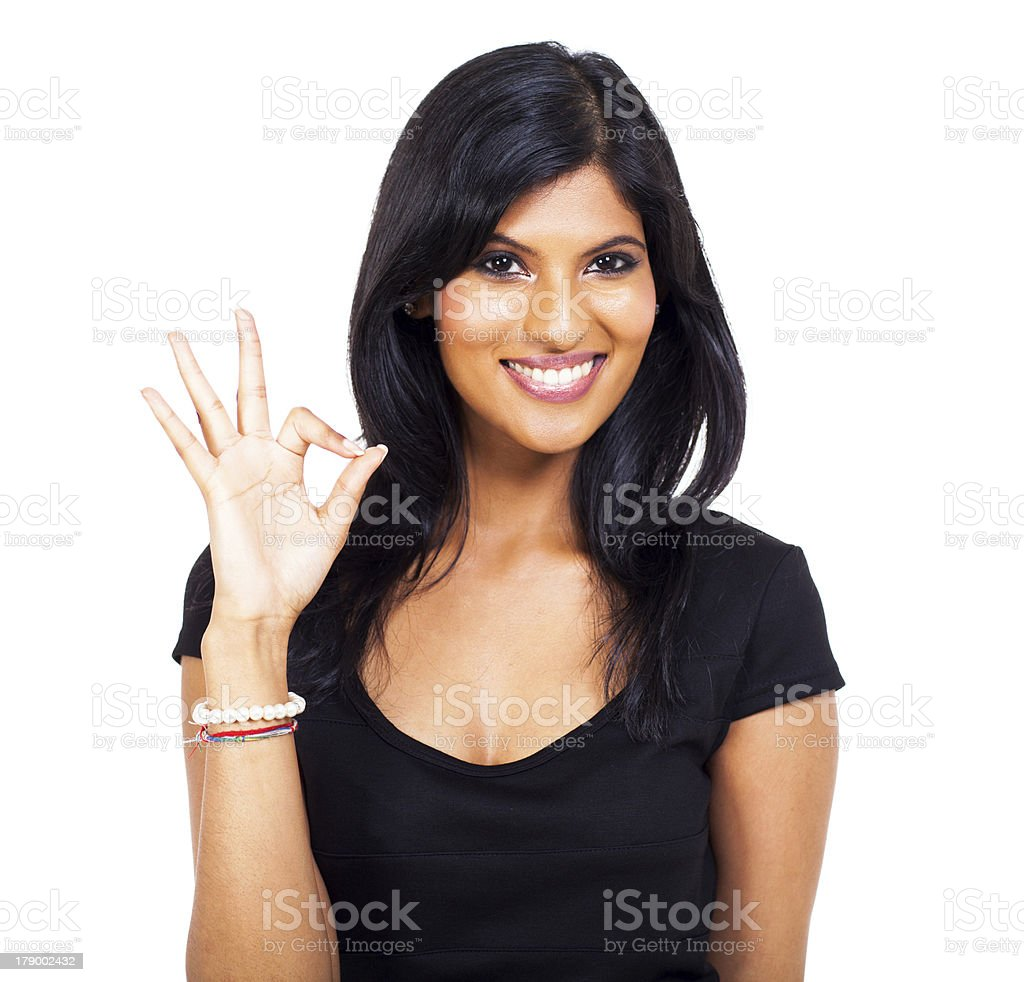 cheerful indian woman ok hand sign royalty-free stock photo