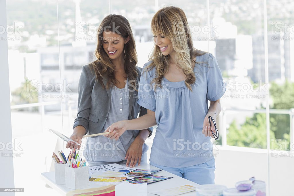 Cheerful interior designers working together in their office royalty-free stock photo