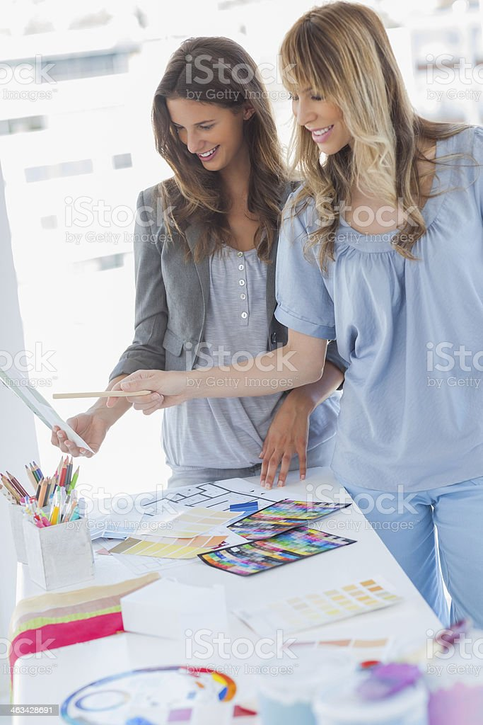 Cheerful interior designers working together royalty-free stock photo