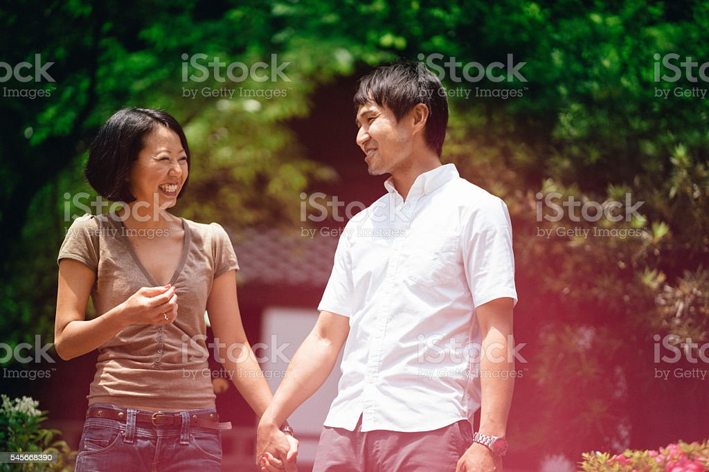 Cheerful japanese couple at the temple, front view stock photo