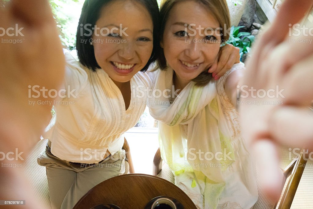 Cheerful Japanese women having a meeting in a traditional cafè stock photo