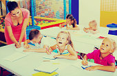 cheerful kids at school lesson