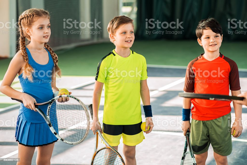 Excited children are listening to trainer with interest. They are...