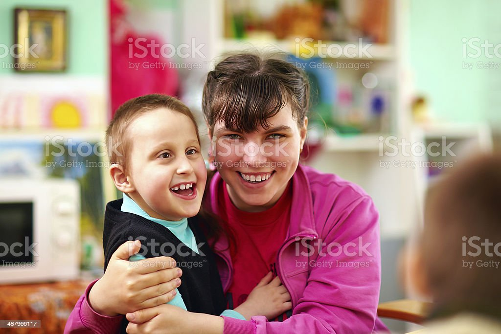 cheerful kids with disabilities in rehabilitation center stock photo