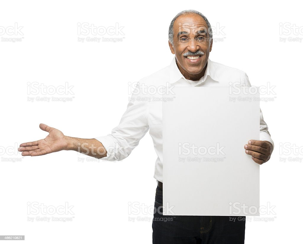 Cheerful latin man holding up sign royalty-free stock photo