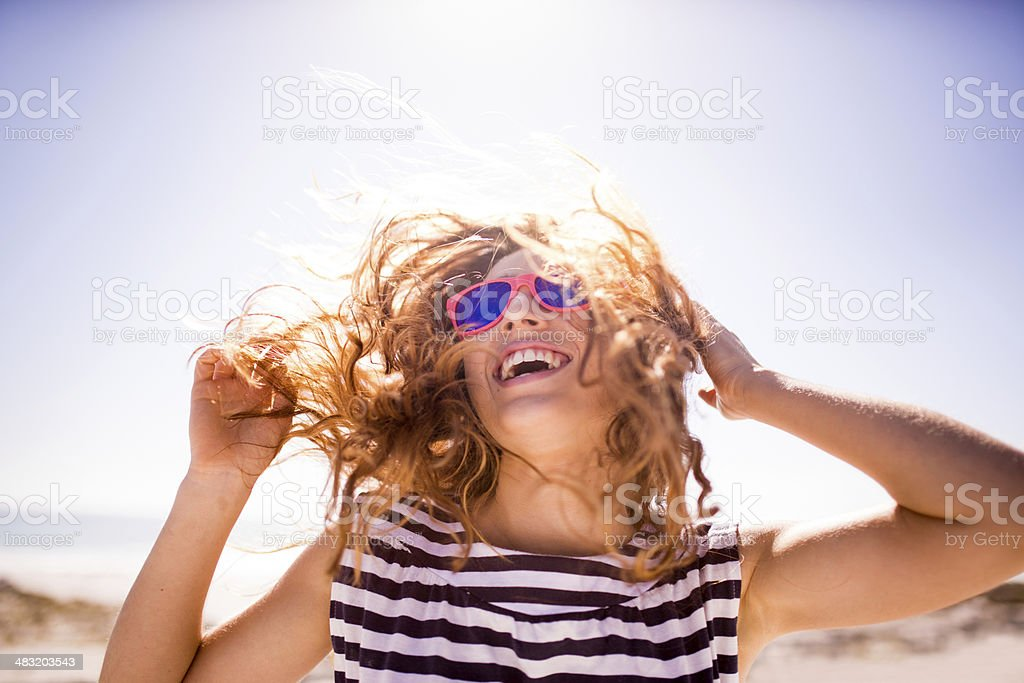 Cheerful laughing woman on the beach stock photo
