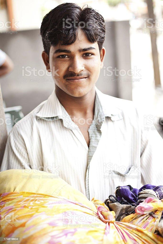 Cheerful Laundry man in India stock photo