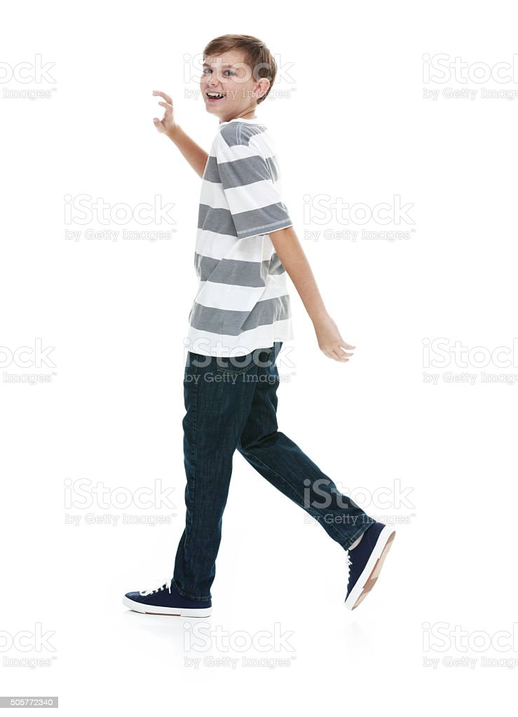 Cheerful little boy walking stock photo