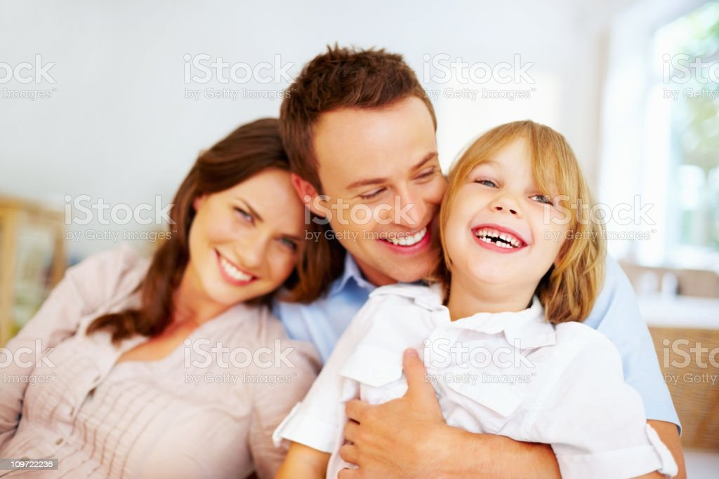 Cheerful little boy with his loving father and mother royalty-free stock photo