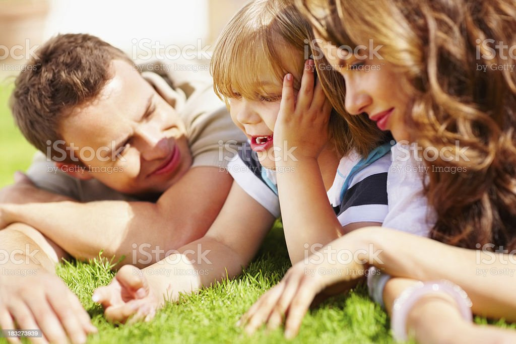 Cheerful little boy with his parents spending time together royalty-free stock photo