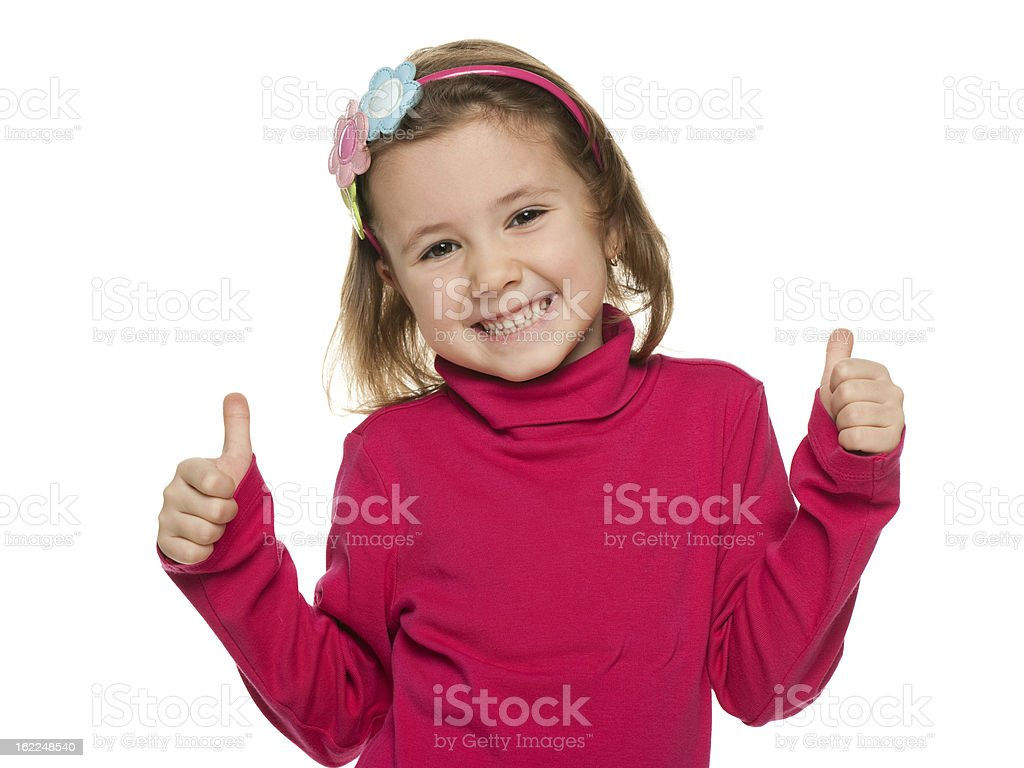 Cheerful little girl in red with her thumbs up royalty-free stock photo