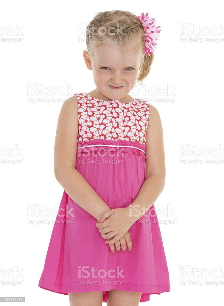 Joyeuse petite fille souriant sur fond blanc. photo libre de droits