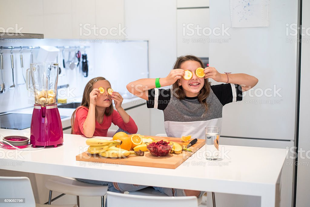 Cheerful little girls in the kitchen stock photo