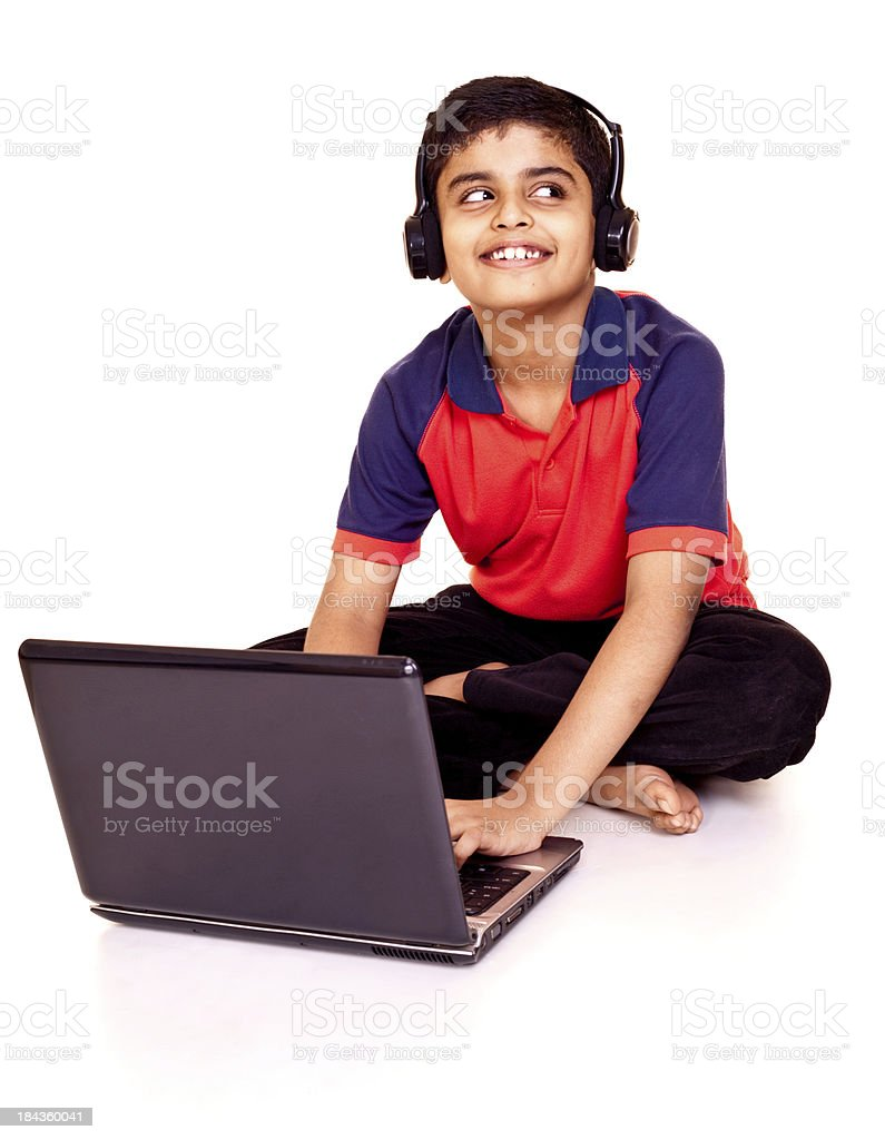 Cheerful Little Indian Boy Using Laptop Isolated on White Background royalty-free stock photo