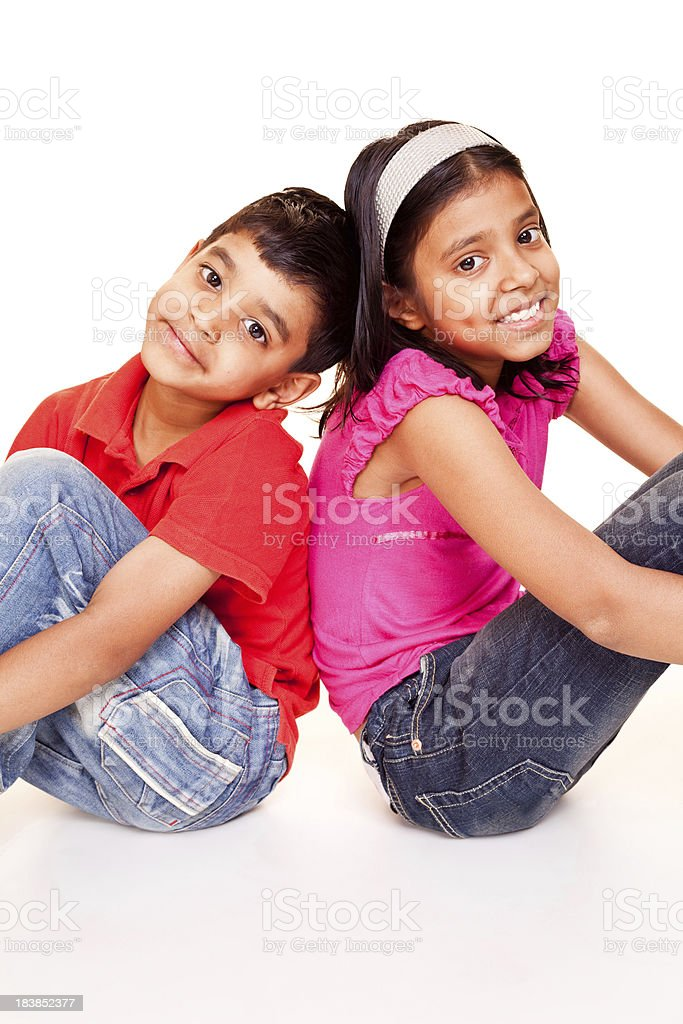 Cheerful Little Indian Brother Sister Sitting Isolated on White royalty-free stock photo