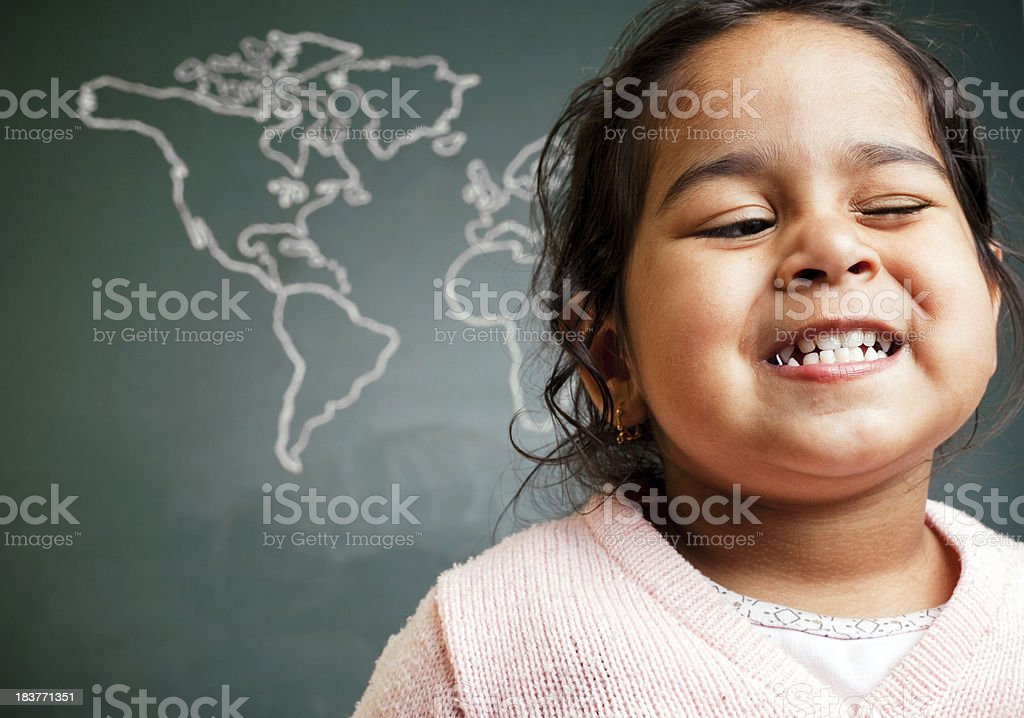 Cheerful Little Indian Preschool Girl in Front of World Map royalty-free stock photo